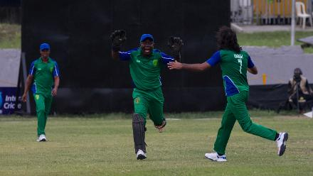 Sierra Leone's Hari Ram Bhamu celebrates a wicket with Mohamed Hansarau