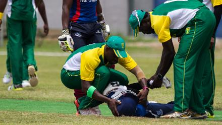 Nigeria players tend to an injured Gambia player