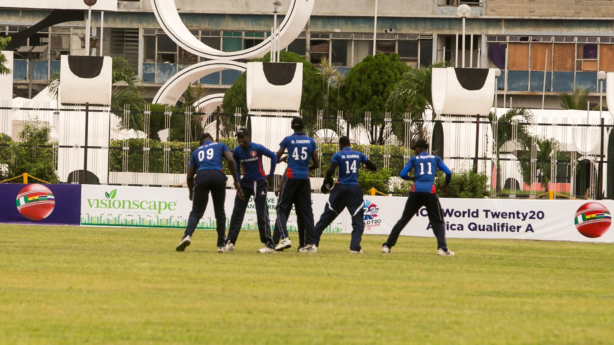 Team Gambia celebrate the fall of a wicket