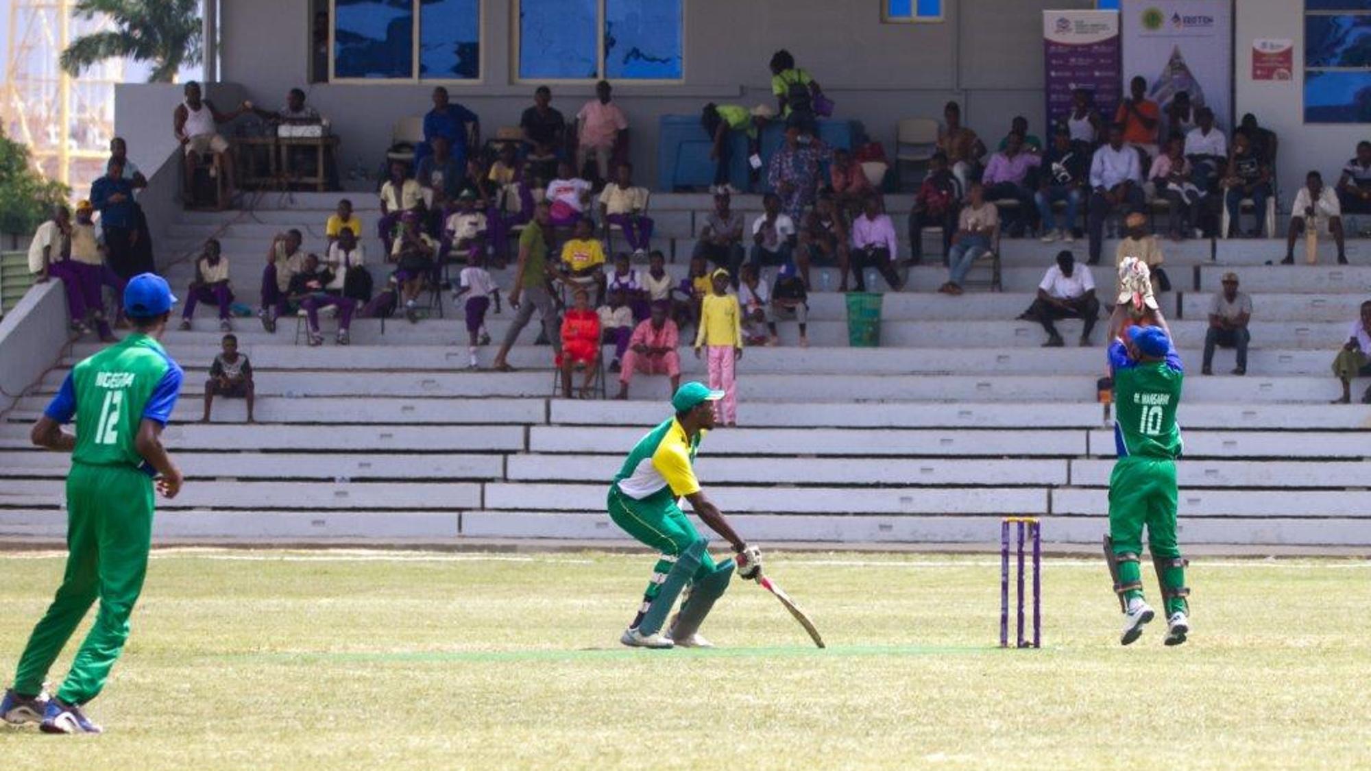 Mohammed Mansaray (Sierra Leone) gathers the ball as Chimezie Onwuzilike (Nigeria) watches on