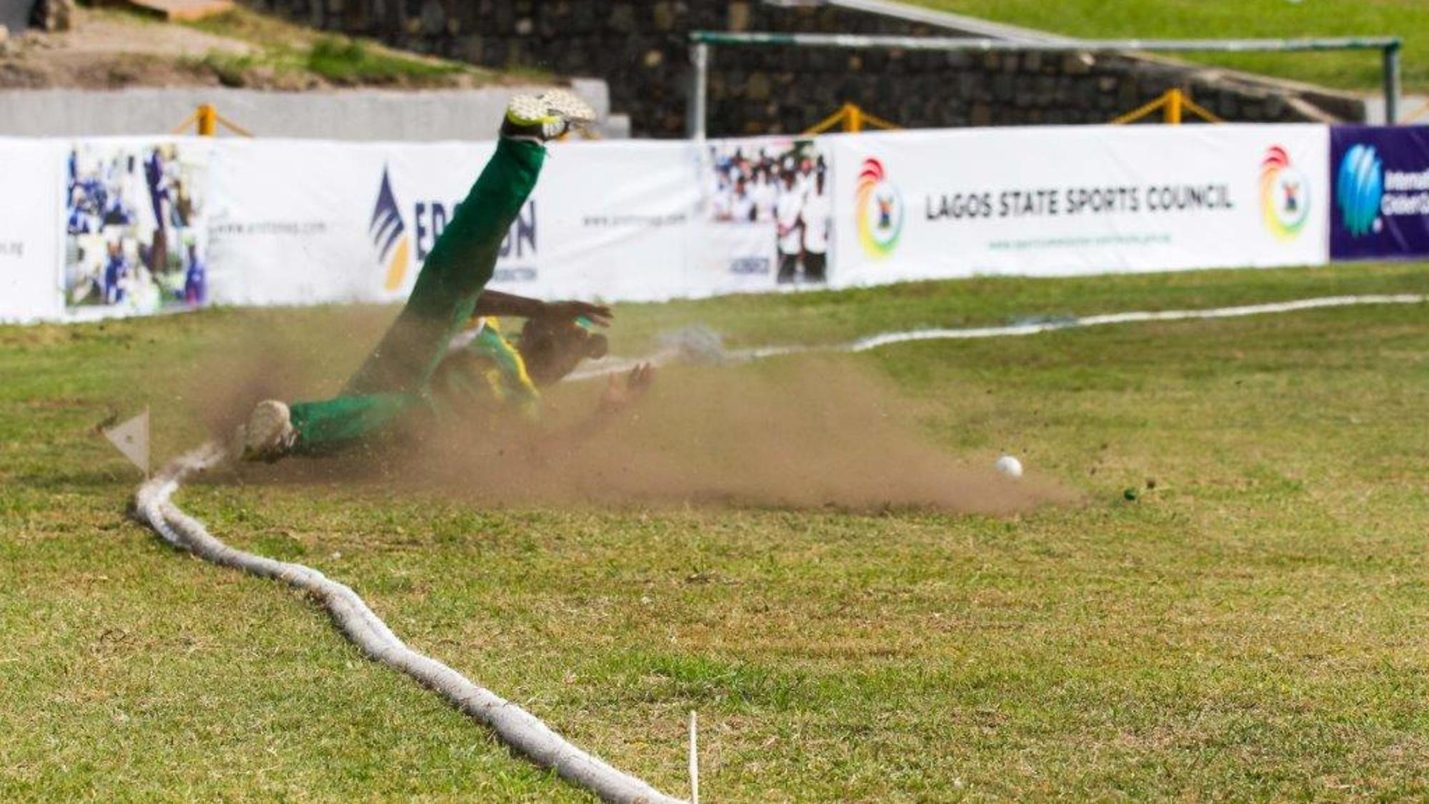 Saheed Akolade (Nigeria) with a desperate dive to save a boundary
