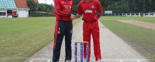 Captains of Jersey and Denmark shake hands ahead of their WCL division 4 encounter