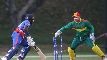Vanuatu's wicketkeeper Shane Deitz dismisses Kamau Leverock, the Bermuda opener, for 12