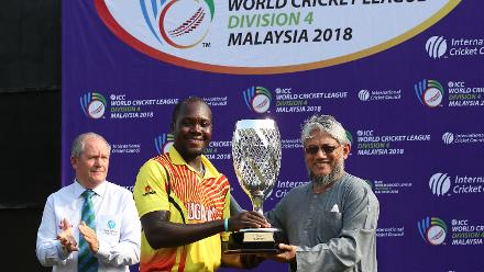 Uganda captain receives the WCL Div 4 champions trophy