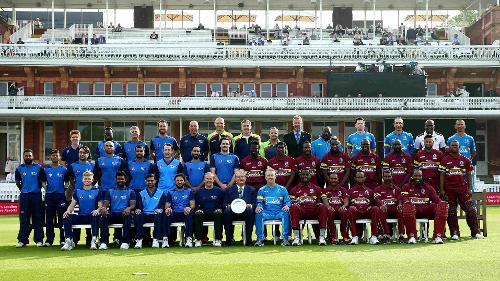 The ICC World XI and the Windies sides line up for a commemorative photograph
