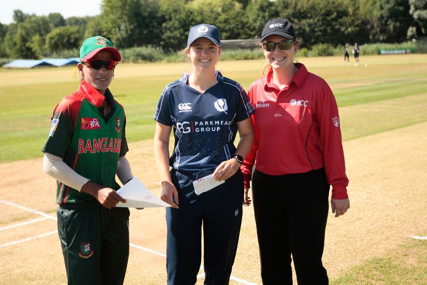 Kathryn Bryce tosses up with Salma Khatun of Bangladesh in a warm-up match