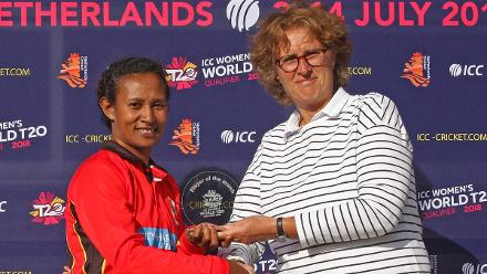 Mairi Tom is presented with the Player of the Match Trophy by KNCB President Betty Timmer for her 4 for 24 from 4 overs, Netherlands v PNG, VRA, 10th July 2018
