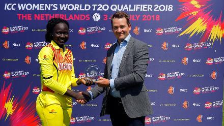 Mr Bernard of Kampong Cricket Club presenting the Player of the Match award to G Candiru, 1st Play-off Semi-Final, ICC Women's World Twenty20 Qualifier at Utrecht, Jul 12th 2018.
