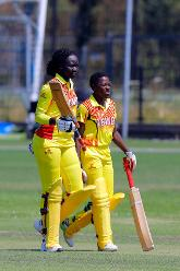 G Candiru and Musamali celebrate the win over Netherlands, 1st Play-off Semi-Final, ICC Women's World Twenty20 Qualifier at Utrecht, Jul 12th 2018.