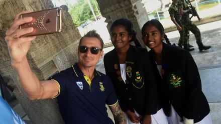 Dale Steyn takes a selfie with schoolgirls on Mandela Day
