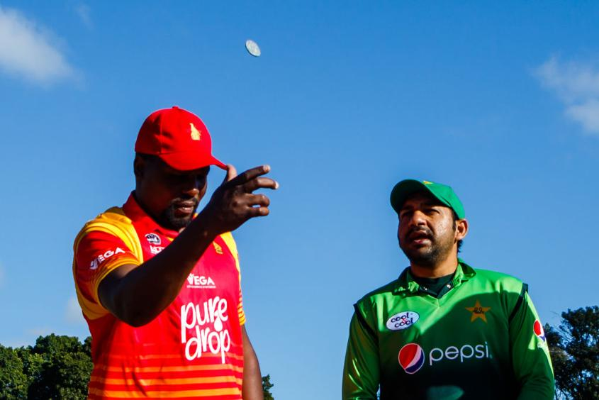 Skippers Hamilton Masakadza and Sarfraz Ahmed at the toss