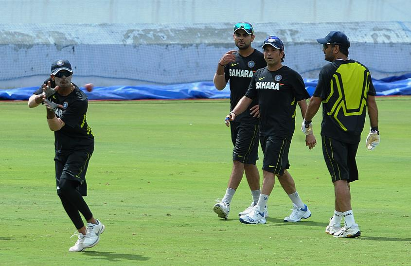 Kohli, Tendulkar and Dhoni during a training session in 2012