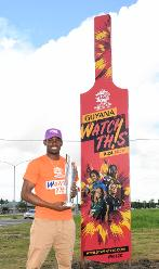 Keemo Paul holds the Women's World T20 trophy