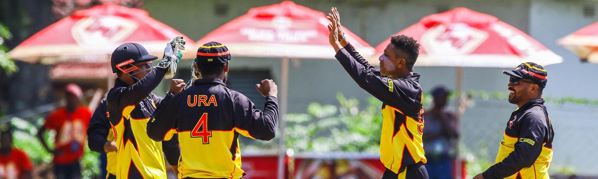 PNG bowler CJ Charles Amini celebratesa a wicket with his team mates during a play off match between Hong Kong and Papua New Guinea in the World Cup Quailfiers played at Old Hararians, March 17 2017 (©ICC).