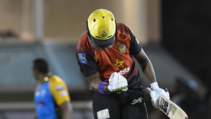 Bravo celebrates after Trinbago crossed the line with one ball to go