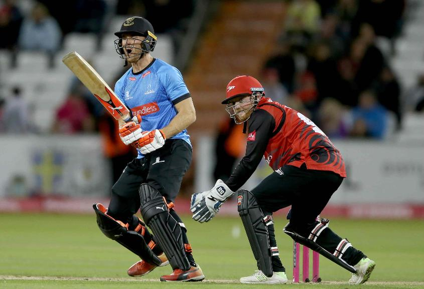 Laurie Evans celebrates after hitting the winning runs