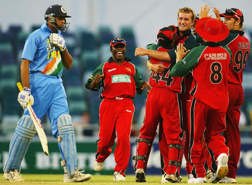 Ervine celebrates dismissing India legend VVS Laxman in an ODI in 2004