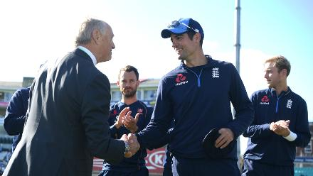Cook receives a commemorative cap from ECB Chairman Colin Graves to mark his final Test appearance