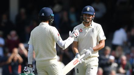 Moeen Ali is the first to congratulate Cook after the half-century