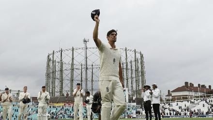 Alastair Cook walks out of a cricket ground for one final time