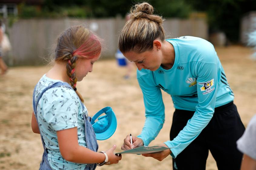 Taylor signs autographs during this year's Women's Super League