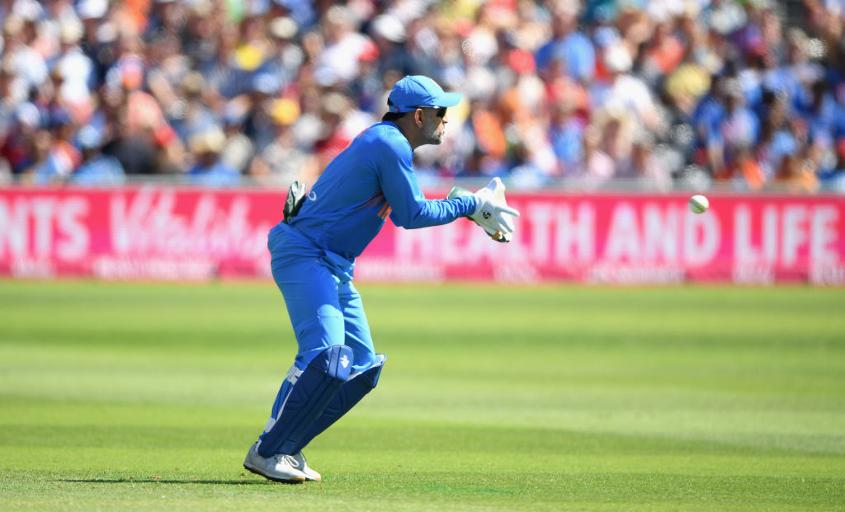 MS Dhoni catches a ball whilst keeping wicket for India in the ODI series in England