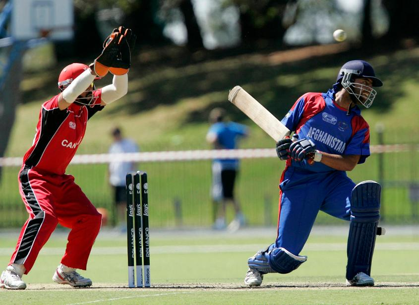 Noor Ali Noori of Afghanistan avoids a bouncer during the ICC Cricket World Cup qualifier match against Canada