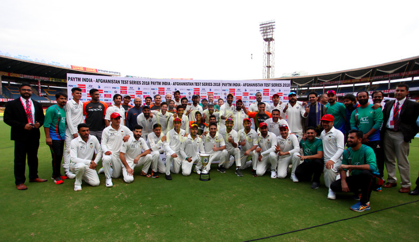 Afghanistan players with the Indian team after their inaugural Test match