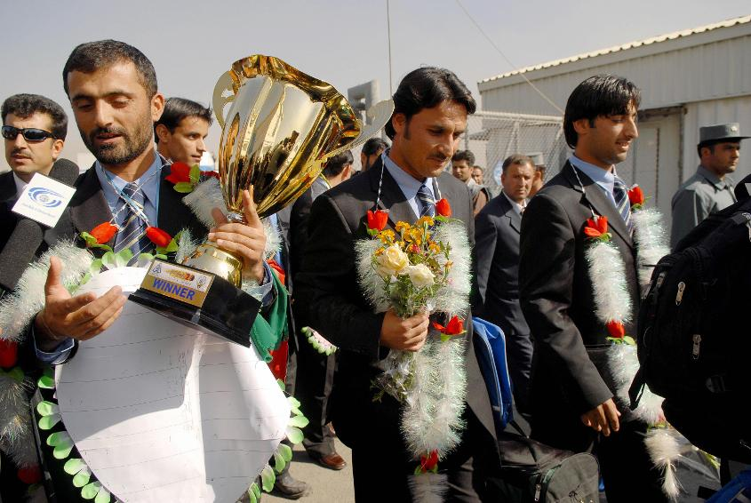 Afghan Cricket players arrive at Kabul airport after returning from the Asian Cricket Council Twenty20 Cup in November 2007