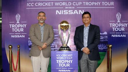 BCB Director Shafiul Alam and District Sports Association General Secretary Mahiuddin Selim pose with the trophy
