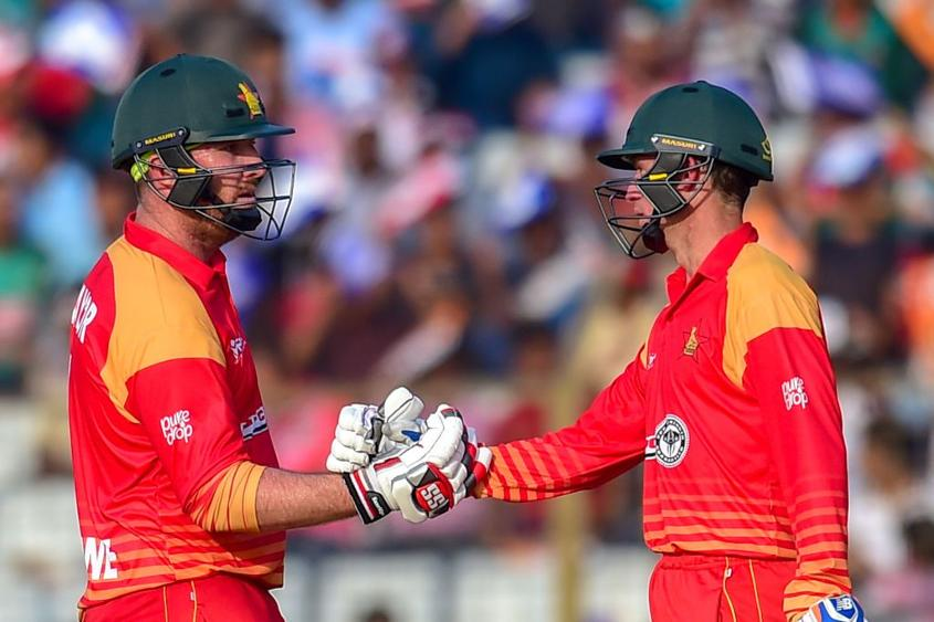 Brendan Taylor (L) celebrates with Sean Williams after reaching 50 during the third ODI between Bangladesh and Zimbabwe
