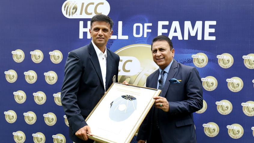 Rahul Dravid poses with his ICC Cricket Hall of Fame cap and Sunil Gavaskar