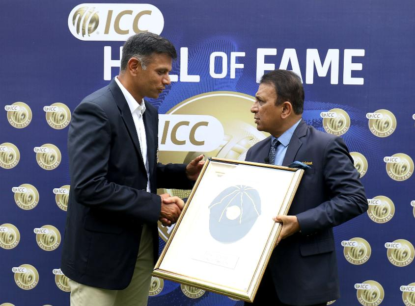 Rahul Dravid receives his ICC Cricket Hall of Famer cap from fellow ICC Cricket Hall of Famer and former India captain Sunil Gavaskar