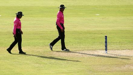 Umpires Gregory Brathwaite and Jacquline Williams make their way out onto the pitch during the warm up match between West Indies and New Zealand ahead of the ICC Women's World T20 2018 tournament at Guyana National Stadium on November 7, 2018.