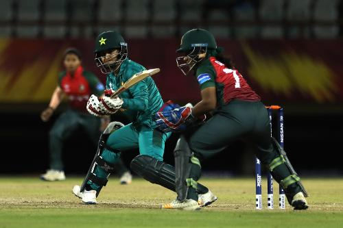 Bismah Maroof of Pakistan plays a reverse sweep as Shamima Sultana of Bangladesh looks on during the warm up match between Bangladesh v Pakistan: Warm Up - ICC Women's World T20 2018 November 6, 2018 at the Guyana National Stadium in Providence, Guyana.