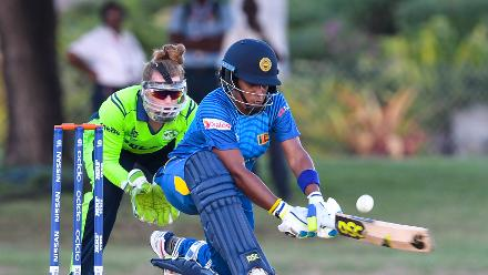 Chamari Athapaththu (R) of Sri Lanka hits 4 as Mary Waldron (L) Ireland watch during a warm-up match at Coolidge Cricket Ground on November 7, 2018 in Coolidge, Antigua and Barbuda.