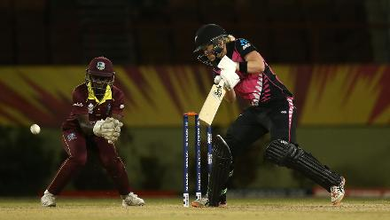 Maddy Green of New Zealand bats with Kycia Knight of Windies looking on during the warm up match between Windies and New Zealand ahead of the ICC Women's World T20 2018 tournament at Guyana National Stadium on November 7, 2018.