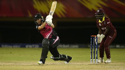 Sophie Devine of New Zealand bats with Kycia Knight of Windies looking on during the warm up match between Windies and New Zealand ahead of the ICC Women's World T20 2018 tournament at Guyana National Stadium on November 7, 2018.