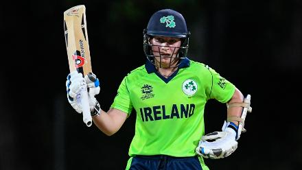 Clare Shillington of Ireland celebrates her half century during a warm-up match at Coolidge Cricket Ground on November 7, 2018 in Coolidge, Antigua and Barbuda.