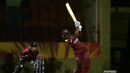 Stafanie Taylor of Windies bats with Katey Martin of New Zealand looking on during the warm up match between Windies and New Zealand ahead of the ICC Women's World T20 2018 tournament at Guyana National Stadium on November 7, 2018 in Georgetown, Guyana.