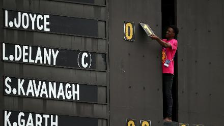 A scoreboard operator makes adjustments during the ICC Women's World T20 2018 match between India and Ireland at Guyana National Stadium on November 15, 2018 in Providence, Guyana.