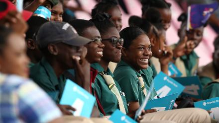 Local school children enjoy the atmosphere during the ICC Women's World T20 2018 match between India and Ireland at Guyana National Stadium on November 15, 2018 in Providence, Guyana.