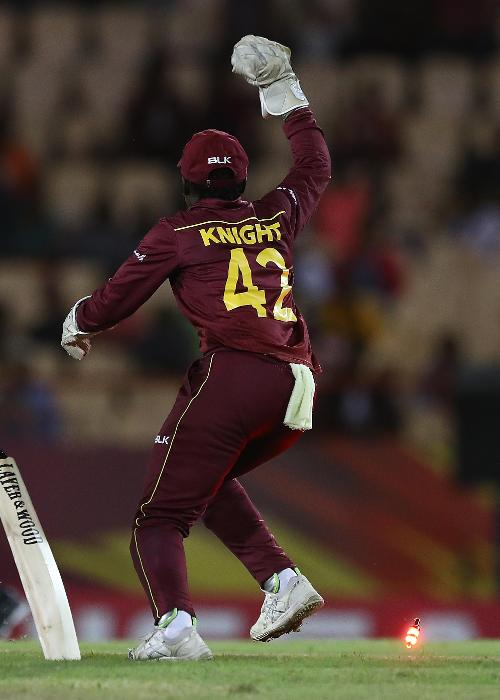 Kycia Knight of West Indies celebrates the run out of Dane van Niekerk of South Africa during the ICC Women's World T20 2018 match between West Indies and South Africa at Darren Sammy Cricket Ground on November 14, 2018 in Gros Islet, Saint Lucia.