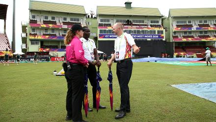 Match officials inspect the playing field during the ICC Women's World T20 2018 match between India and Ireland at Guyana National Stadium on November 15, 2018 in Providence, Guyana.
