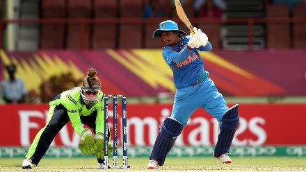 Mithali Raj of India bats with Mary Waldron wicket keeper of Ireland looking on during the ICC Women's World T20 2018 match between India and Ireland at Guyana National Stadium on November 15, 2018 in Providence, Guyana.