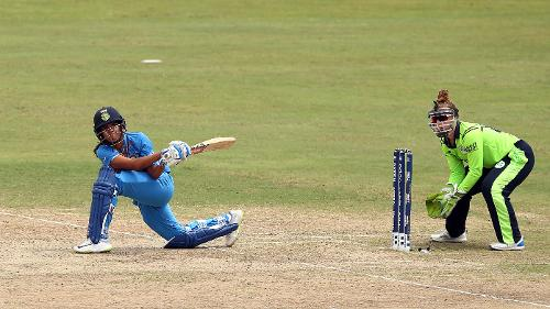 Veda Krishnamurthy of India bats with Mary Waldron wicket keeper of Ireland looking on during the ICC Women's World T20 2018 match between India and Ireland at Guyana National Stadium on November 15, 2018 in Providence, Guyana.