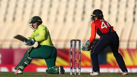 Lizelle Lee of South Africa sweeps the ball, as Amy Jones of England looks on during the ICC Women's World T20 2018 match between England and South Africa at Darren Sammy Cricket Ground on November 16, 2018 in Gros Islet, Saint Lucia.