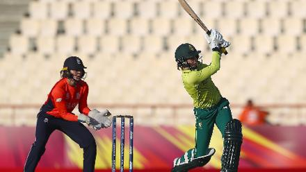 Marizanne Kapp of South Africa hits the ball towards the boundary as Amy Jones of England looks on during the ICC Women's World T20 2018 match between England and South Africa at Darren Sammy Cricket Ground on November 16, 2018.