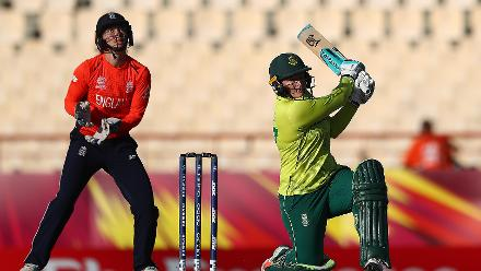 Lizelle Lee of South Africa hits the ball towards the boundary, Anya Shrubsole of England Amy Jones of England looks on during the ICC Women's World T20 2018 match between England and South Africa at Darren Sammy Cricket Ground on November 16, 2018.