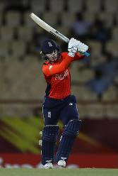 Tammy Beaumont of England hits the ball towards the boundary during the ICC Women's World T20 2018 match between England and South Africa at Darren Sammy Cricket Ground on November 16, 2018 in Gros Islet, Saint Lucia.